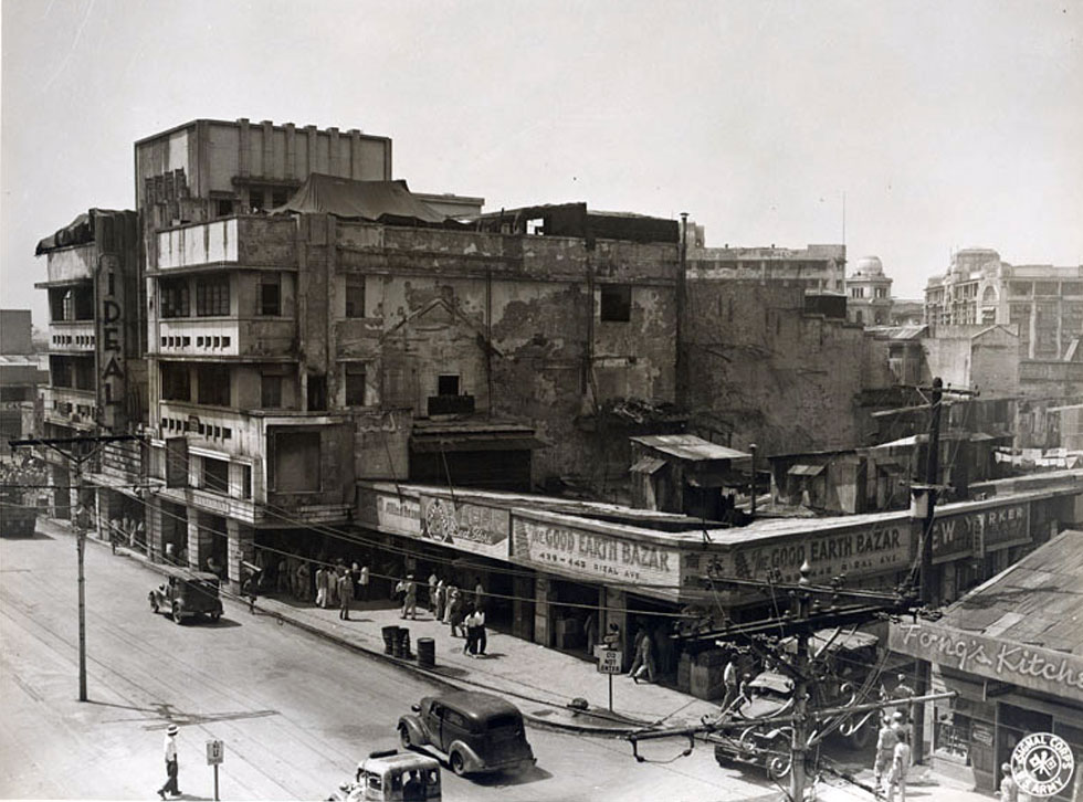 The ravages of war reflected on surviving buildings. Rizal Ave. corner Bustos, 1945
